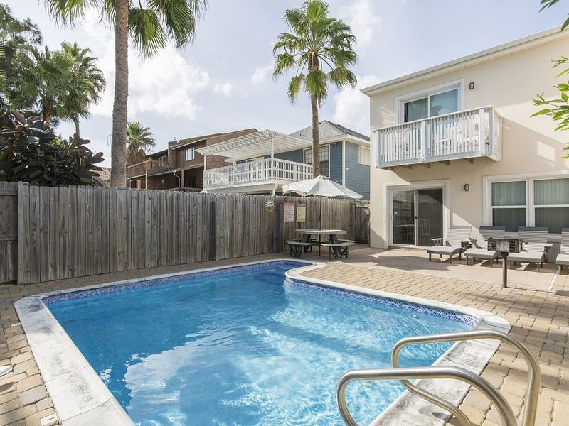 Enjoy the private heated pool and ample backyard!