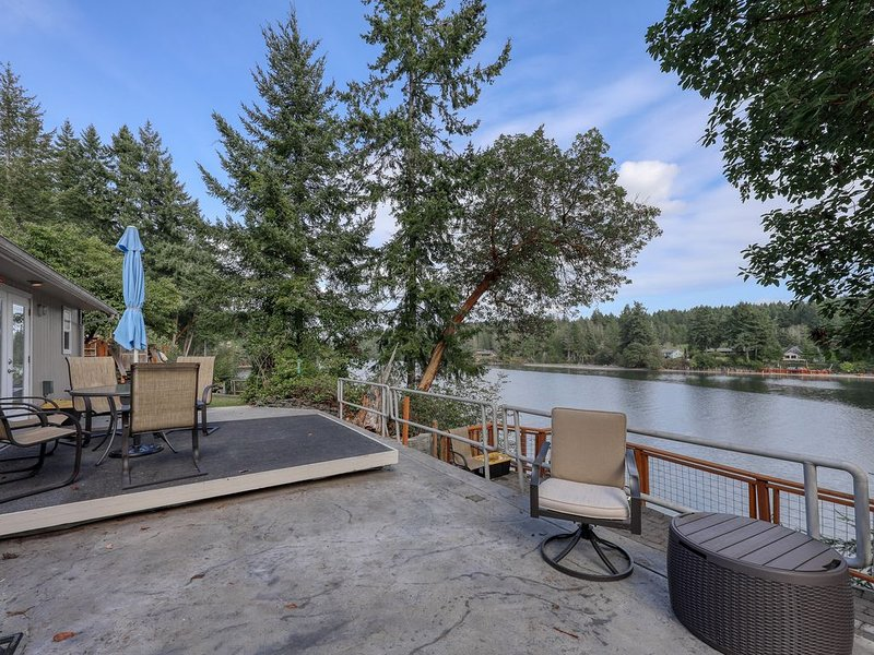 Beachfront retreat for six people with large decks, hot tub, views of nature, holiday rental in Lakebay