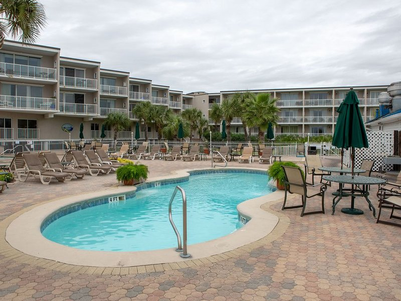 One of the pools with our building facing it in the back!