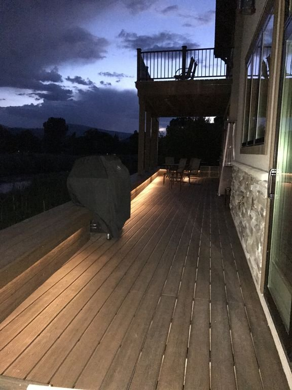 Lighting on back deck that spans the entire width of the house.