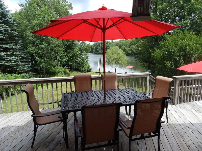 The second floor deck provides a great space for dining and watching the lake.