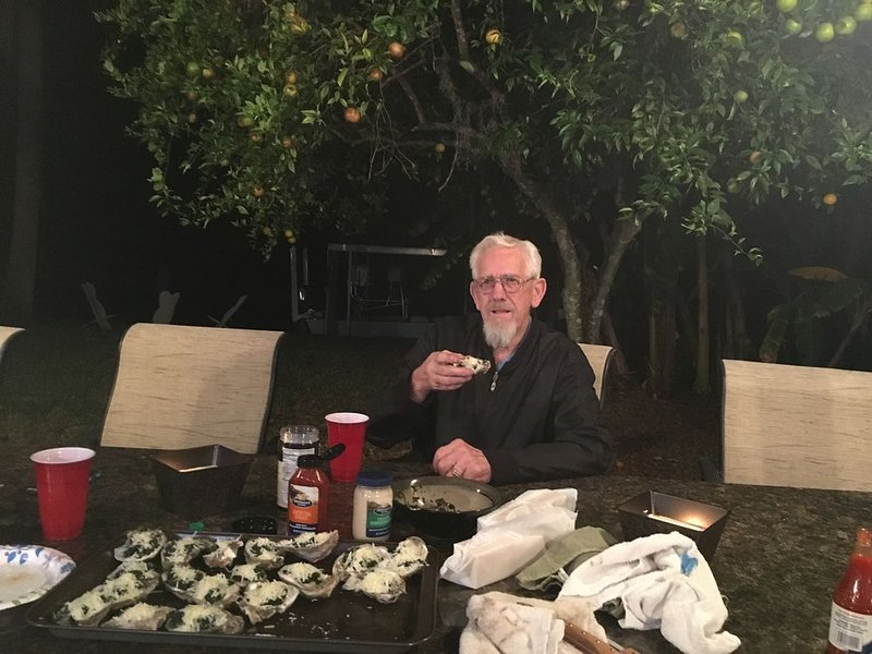 Uncle Pete enjoying Oysters Rockefeller served in the outdoor kitchen.