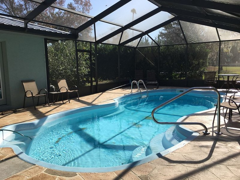Pool, lounge chairs and setting area