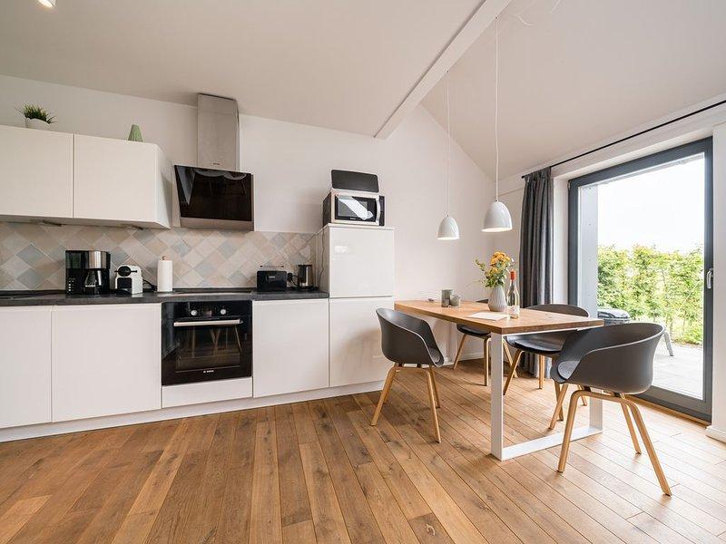 Exklusive Ferienwohnungen im historischen Gulfhof polder72 | Wohnung 6 | Duidelt, holiday rental in Esens