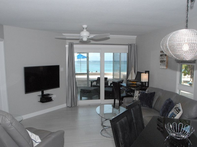 Newly Renovated Ocean Front On Seven Mile Beach Cayman Reef Resort#32, holiday rental in Seven Mile Beach