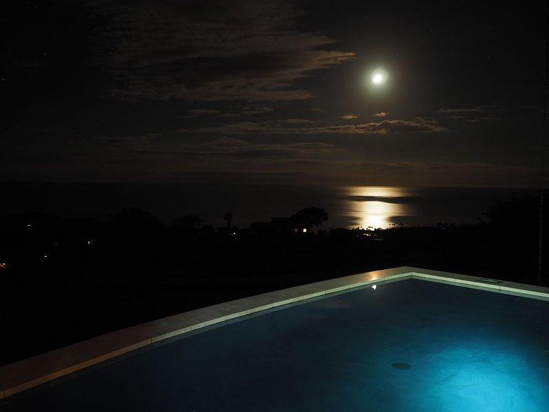 A moon set over the ocean