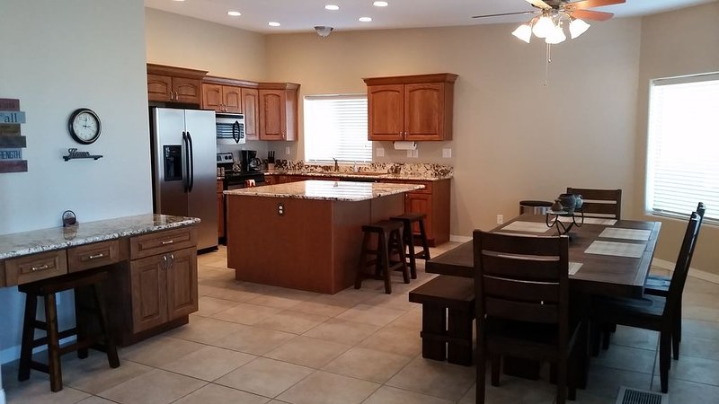 Desk, island & large dining area. Great view of lake from 3 large windows