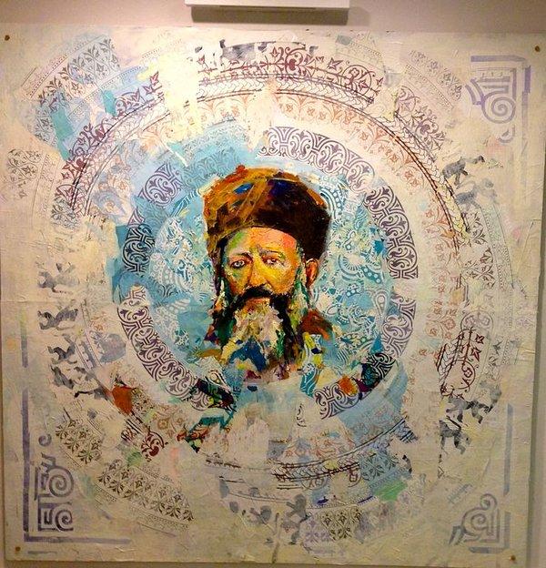 Väggmålning av Rav Kook i lobbyn.
