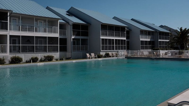 The unit views the pool and river. Close to clubhouse