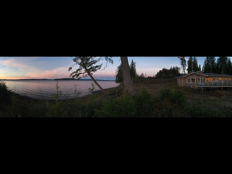 Panorama of house taken by one of my guests!  Jacuzzi on deck along w BBQ/relax!