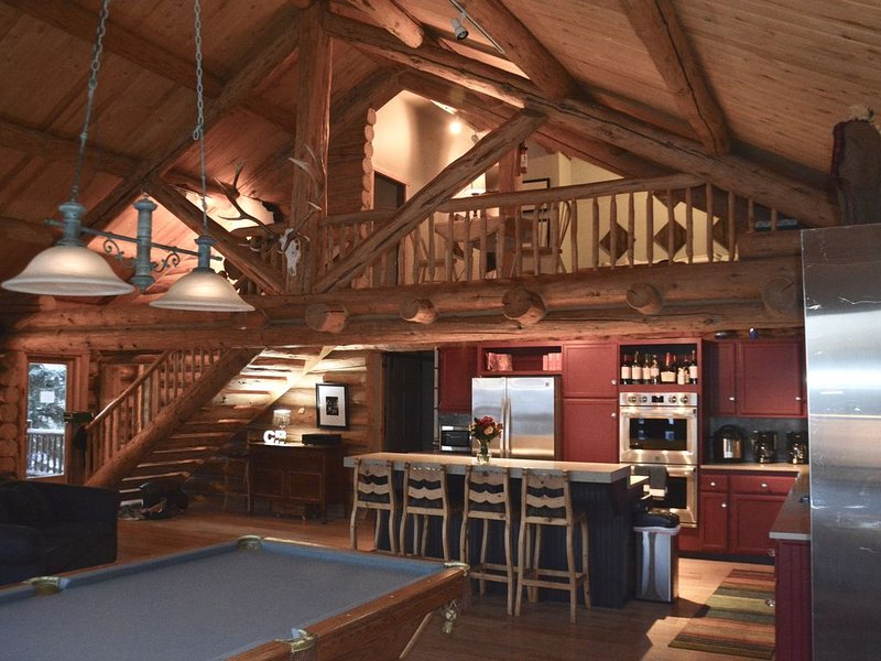 Great room at night looking up to the loft