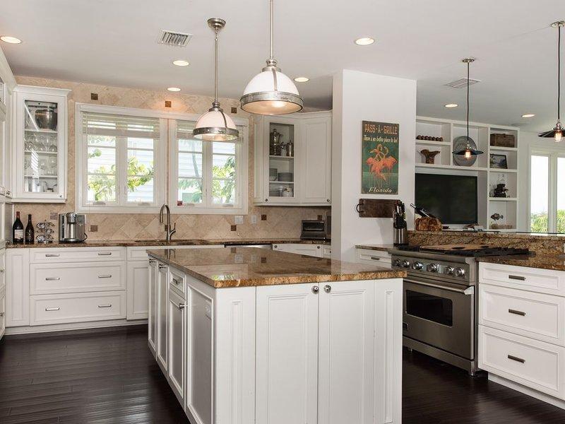 Newly remodeled kitchen with granite and Viking stove and Sub Zero Fridge.