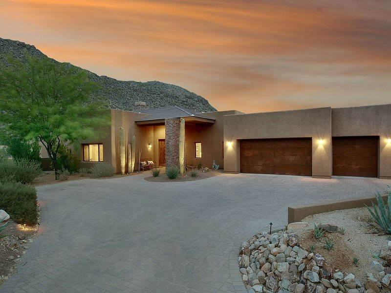 Front entrance with 3 car garage, view of Tortolitas