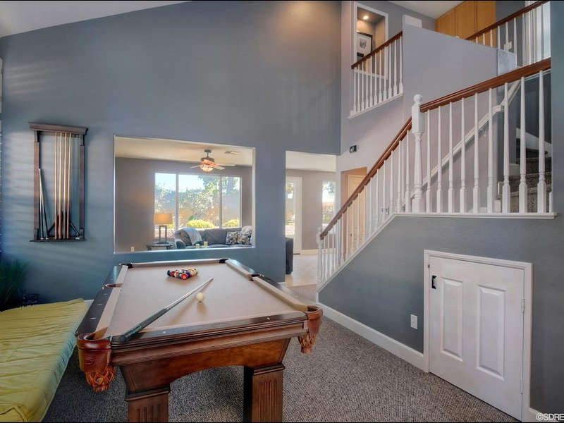 pool table with small door leading to playroom for little ones!
