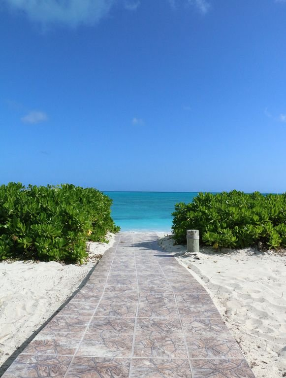 You are just steps to the amazing, secluded white sand and crystal blue waters.