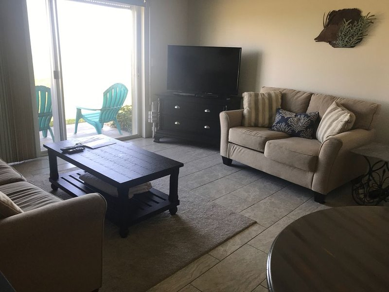 spacious living area with a sleeper sofa and loveseat