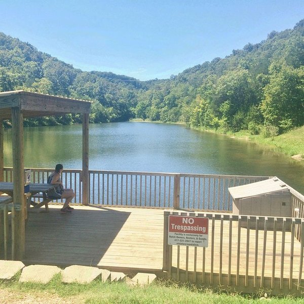 View of the Beautiful 5 acre Private, Stocked Lake with partially covered Dock