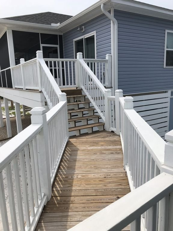 Walkway between houses. gated both ends for privacy but great for large groups.