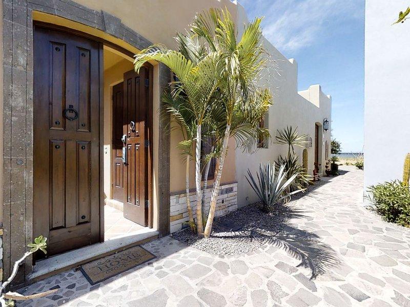 Coastal retreat with sweeping ocean views, a huge patio, AC, WiFi & shared pool!, vacation rental in Loreto