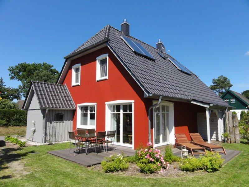 komfortable Ferienhaushälfte in Wieck, Kamin, Sauna, WLAN, Garten, 2 Terassen, alquiler vacacional en Wieck