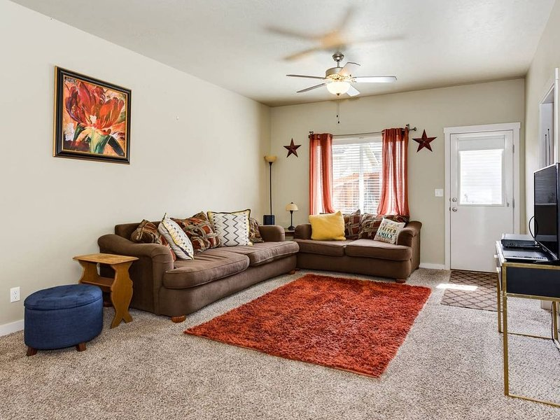 Spacious and comfortable living room designed for relaxing