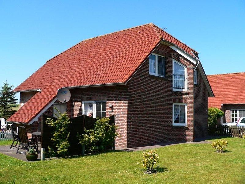 Gemütlich eingerichtetes Ferienhaus direkt am Deich, location de vacances à Krummhoern