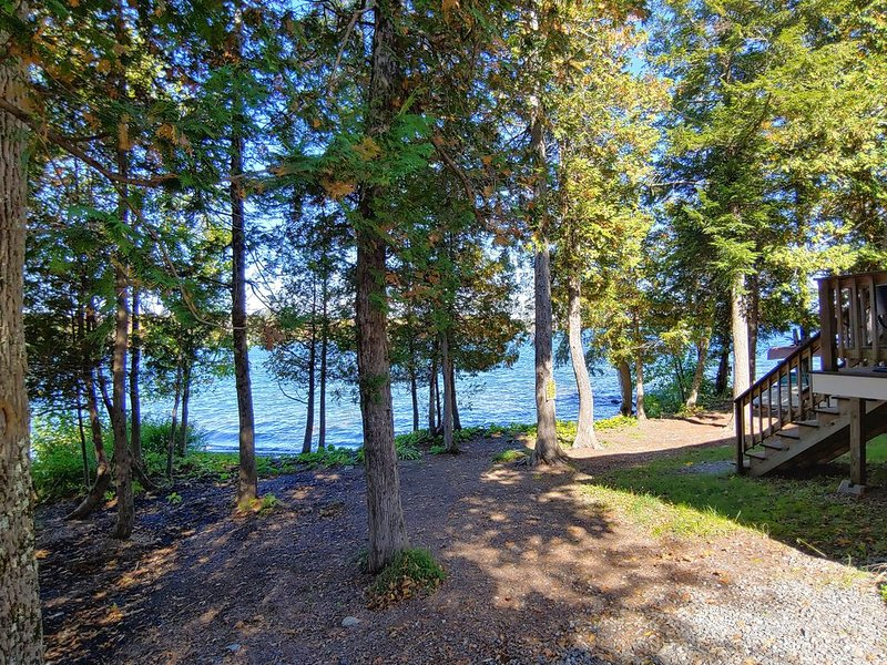 Premium Cleaned | Cozy lakefront home w/ a firepit, outdoor shower, & private be, holiday rental in Sebec