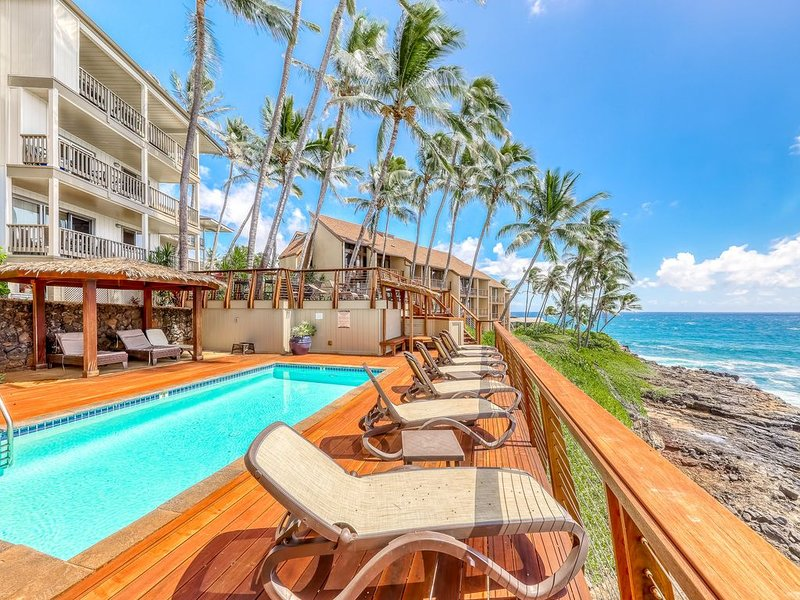 Tropical, oceanfront condo w/ a shared, outdoor pool & furnished deck, holiday rental in Poipu