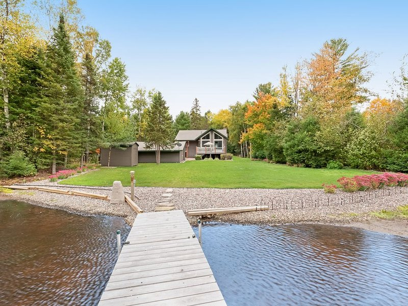 Premium Cleaned | Private lakefront home w/ boat dock, fireplace, large yard - d, vacation rental in Manitowish Waters