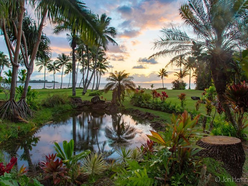 The 1-acre, oceanfront, landscaped property is a tranquil place to meander.