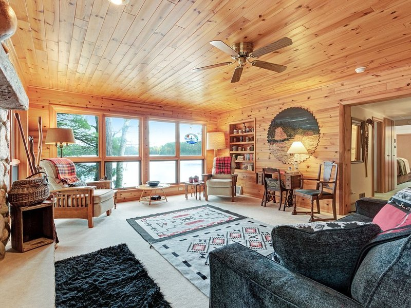 Dog-friendly, lakefront cabin w/ seasonal swim raft, firepit, gas fireplace, holiday rental in Star Lake