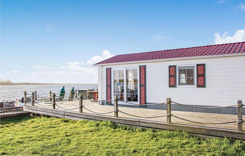 2 Zimmer Unterkunft in Lauwersoog, holiday rental in Westernieland