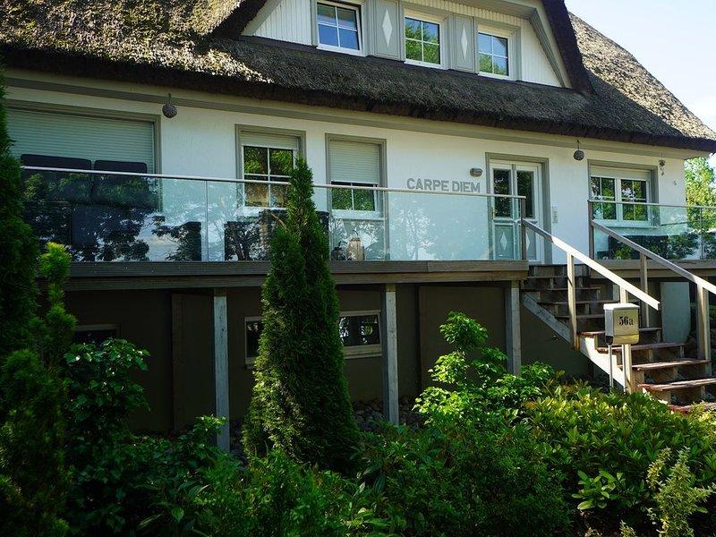 Traumhafte Ferienwohnung am Bodden mit Garten, vakantiewoning in Thiessow