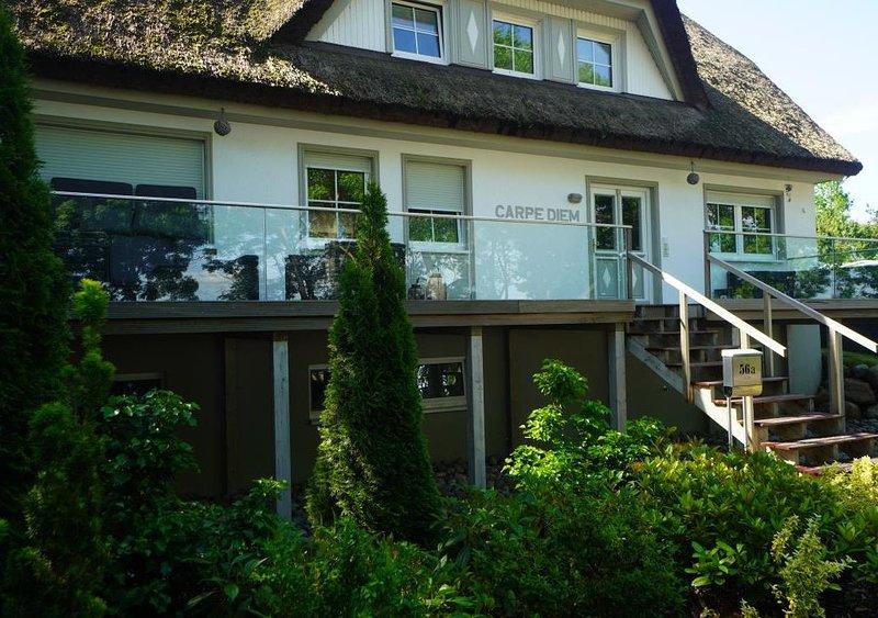 Traumhafte Ferienwohnung am Bodden mit großem Garten, vakantiewoning in Thiessow
