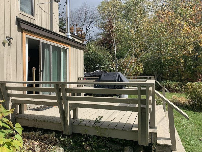 Deck with gas grill and view of golf course