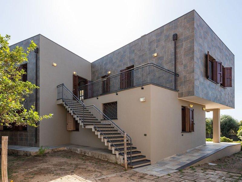 Gemütliche Ferienwohnung Villa Fico 2 mit Balkon, Garten und Klimaanlage; Parkpl, casa vacanza a Domus de Maria