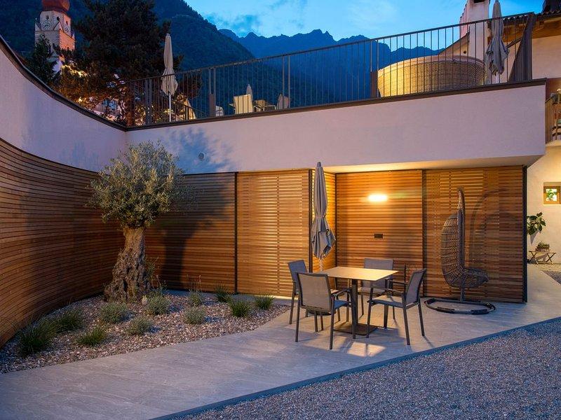 Bezaubernde Ferienwohnung mit Terrasse, Bergblick, WLAN, und Parkplatz; Haustier, location de vacances à Lagundo