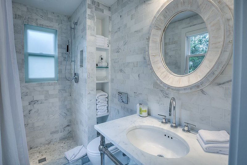 Bathroom with Shower, Toilet, and Pedestal Sink.