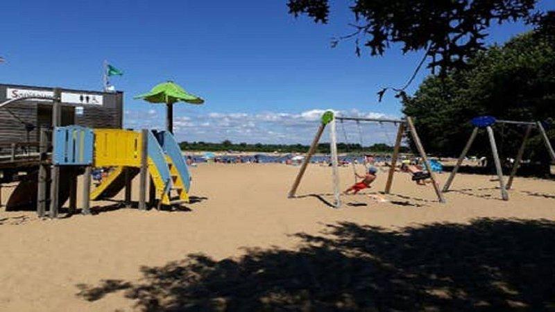 A small artificial beach just behind the apartment 5 mins walk