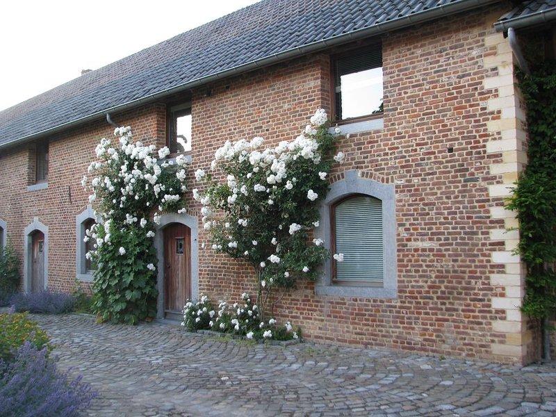 In alle rust logeren op een historisch binnenhof, location de vacances à Heers