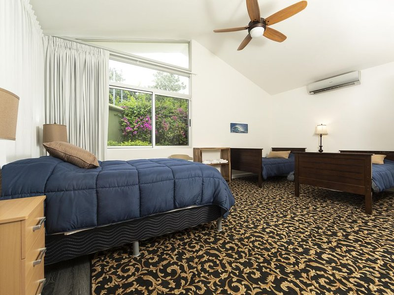 guest room #4 with two single beds and one full size bed