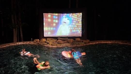 Enjoy the movie projection system by the outdoor pool!