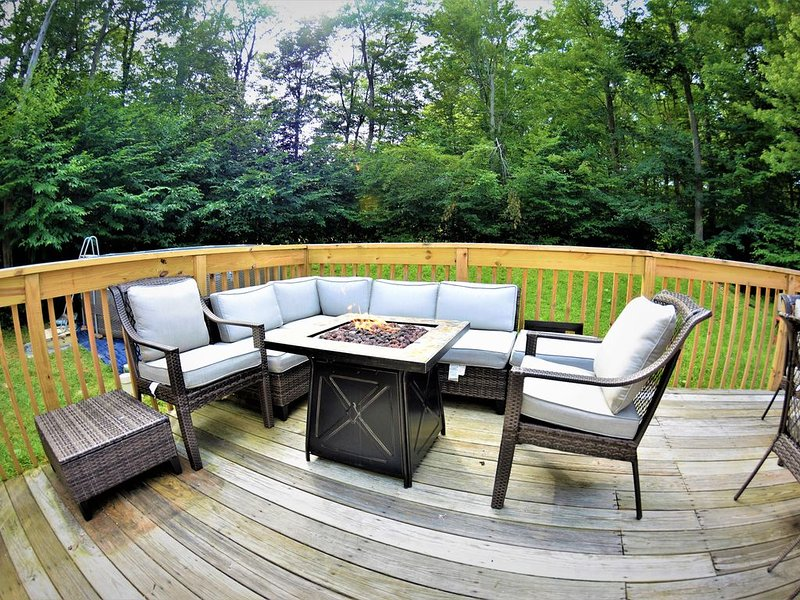 Back Deck Sitting Area with a Gas Firepit.