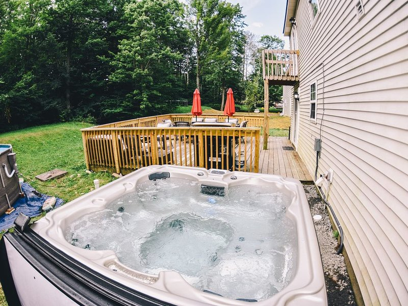 Private Back with a Hot Tub that accommodates 6 people. Open All Year Round.
