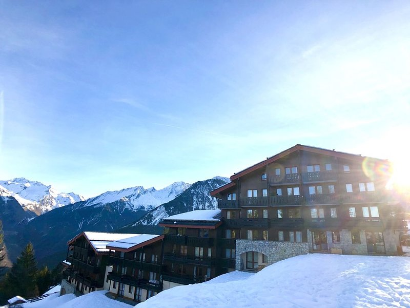 Le Charmantin Courchevel 1550 skis aux pieds, Ferienwohnung in Courchevel