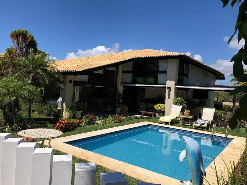 Casa ampla, condomínio fechado em Guarajuba, com piscina, churrasqueira!!!, location de vacances à Jenipabu