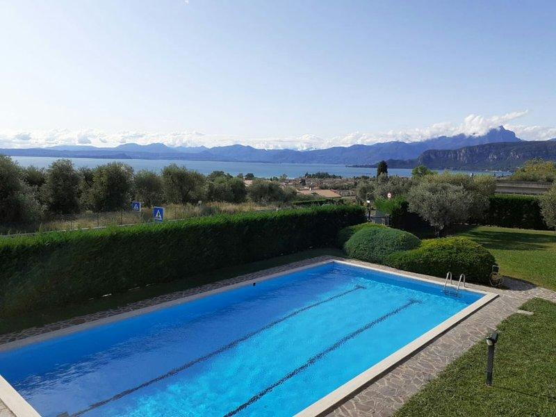 Appartamento vista lago tra i vigneti CIR M**********, aluguéis de temporada em Cavaion Veronese