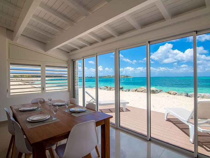 Destination. Beach Front, Water front, Ocean View condo St Martin, holiday rental in Baie Nettle