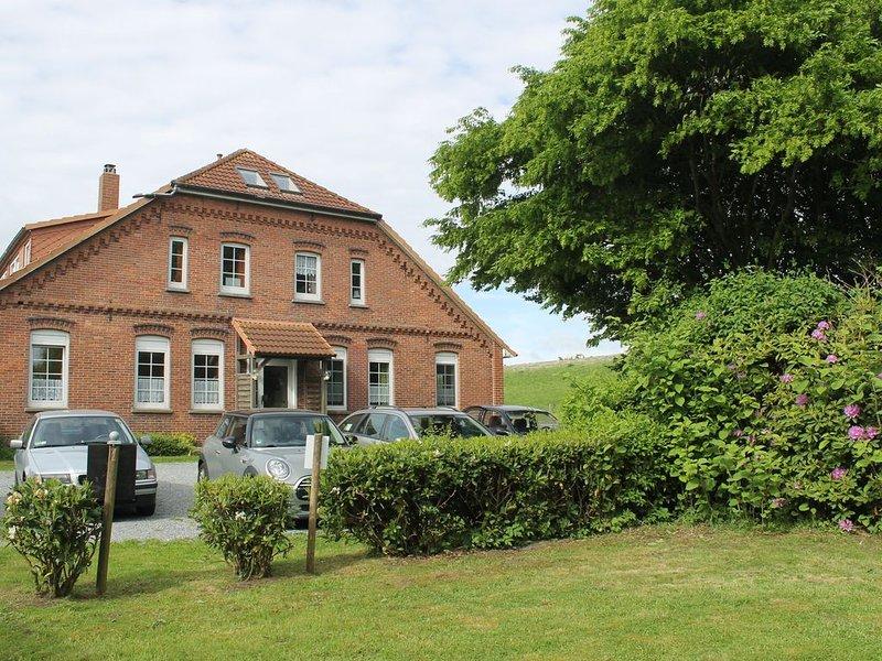 Ferienwohnung direkt am Deich und Watt, location de vacances à Stadland