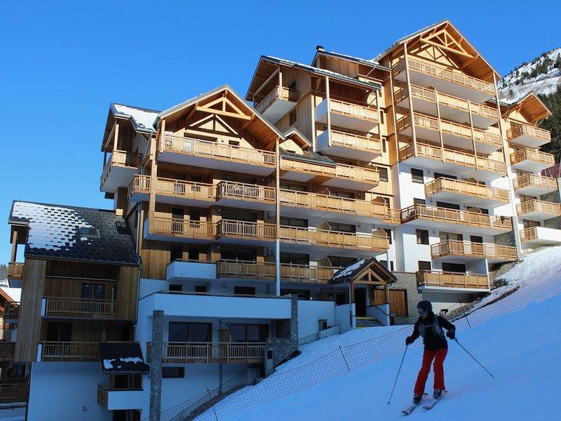 Appartement nouvelle résidence au pied des pistes, location de vacances à Allemond
